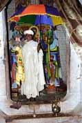 Priest in his monastery at Tana lake. He shows holy relics. North,  Ethiopia.