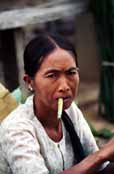Woman smoking cheroot - traditional Burmese cigar. Inle lake area. Myanmar (Burma).