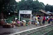 Railway station. People waits for train. They want to sell their products to traders at train. Area around Kalaw village. Myanmar (Burma).