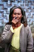 Local woman (from hill tribe) is smoking traditional burma cigar called cheroot. Area around Kalaw village. Myanmar (Burma).