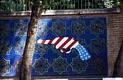 Political propaganda at walls of old US emabassy. Tehran. Iran.
