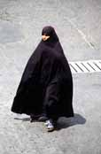 Iran woman. She is dressed in traditional black chador. Tehran. Iran.