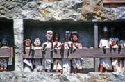 Tau tau figures in front of graves at Lemo. Tana Toraja area. Sulawesi, Indonesia.