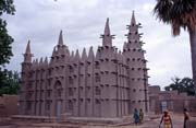 Muddy mosque built at sahel architecture style. Small village near Mopti. Mali.