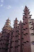 Prayer towers of mosque built at sahel architecture style. Small village near Mopti. Mali.