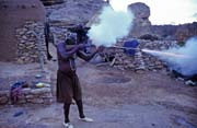 Hunter shows its musket. Begnimato village, Dogon country. Mali.