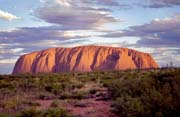 Ayers Rock (Uluru) in afternoon sun. It changes its color according the sunlight. Australia.