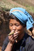 Woman from Pa-O hill tribe is smoking cheroot - traditional Burmese cigar. Villages around Inle Lake. Myanmar (Burma).