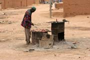 Street snack vendor. He sells roasted meat. Agadez town. Niger.
