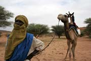 Nomad man together with his camel. Camel is the most frequent transportation option here. Sahara desert. Niger.