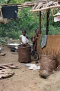 Pygmy village down to the Lobe River. The Pygmy people are forest dwellers, know the forest, its plants and its animals. They live by hunting animals such as antelopes, pigs and monkeys, fishing, and gathering honey, wild yams, berries and other plants. Cameroon.