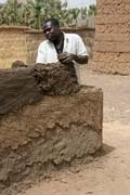 Building or reparing of muddy house. Rey Bouba village. Cameroon.