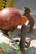 Many locals drink local alcohol which is sold at the market. Market at Tourou village at Mandara Mountains. Cameroon.