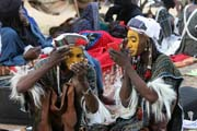 Men from nomadic Wodaabé tribe (also called Bororo) prepare themselves for Yaake dance. Gerewol festival. Niger.