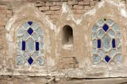Traditional colorful windows at houses at old quarter of Sana capitol. Original window material was alabaster it is exchanged by colorful glass now. Yemen.
