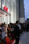 Shopping by japanese style - several hundred meters long queue in front of H&M store. Opening of the first shop of this brand and all are expecting huge discounts. Ginza district, Tokyo. Japan.