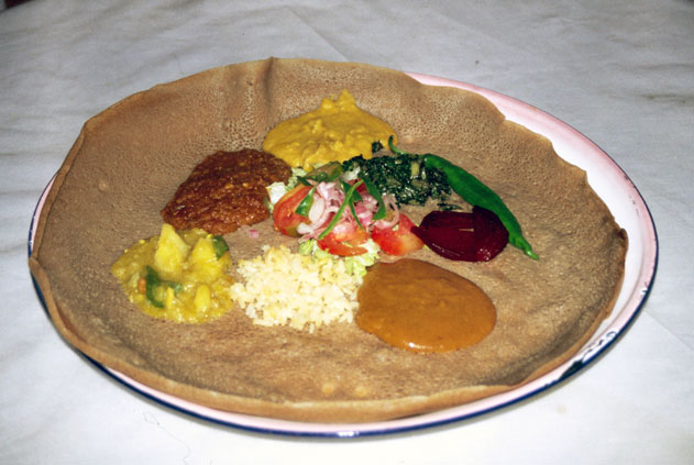 Injera - traditional ethiopian food. It is sour cake with meat or vegetable sauces. North,  Ethiopia.