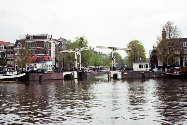 Water channel with bridge. Amsterdam. Netherlands.