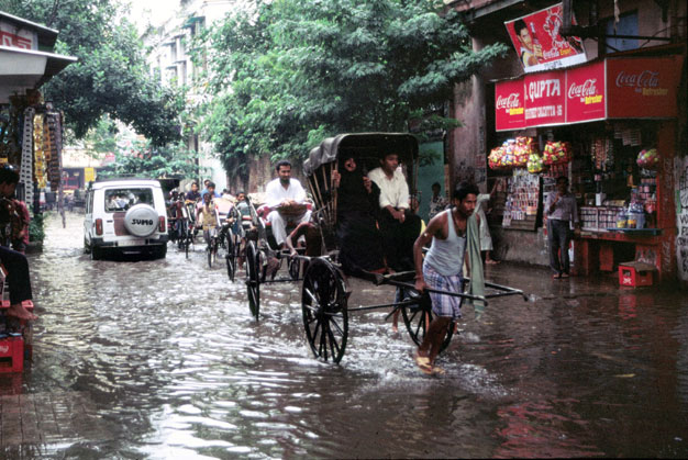 Monsun rain and rikshaws. Calcutta. India.