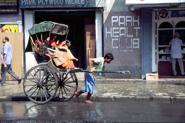 Men pulling rikshaw. Calcutta. India.
