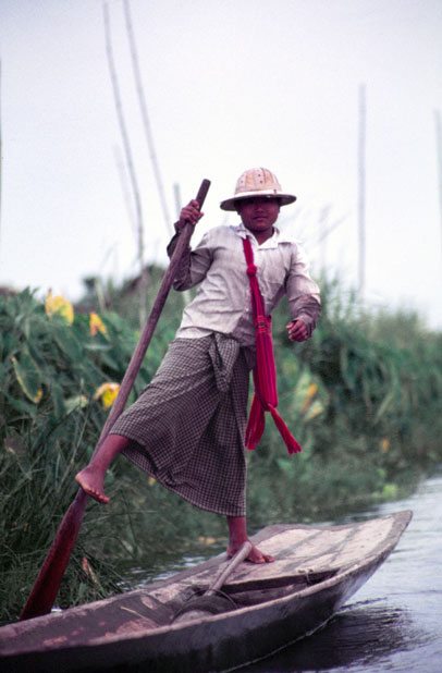 Traditional canoe paddling by leg. Man from Intha tribe. Inle lake. Myanmar (Burma).