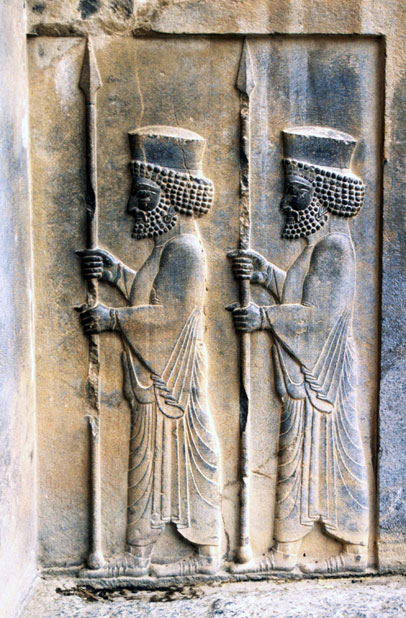Reliefs at tomb of king Artaxerxes II. Persepolis. Iran.