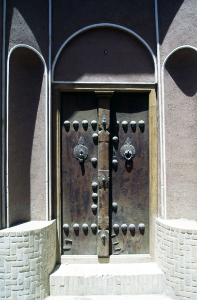 Traditional door at Kashan town. You can see two types of doorbells (they have different sound) - one for men and one for women.  Iran.