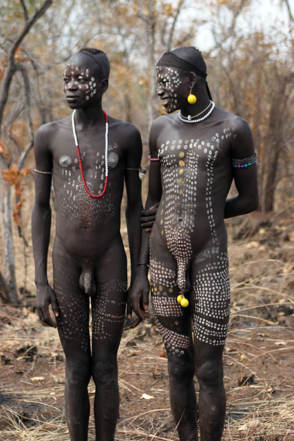 Mursi men. South,  Ethiopia.