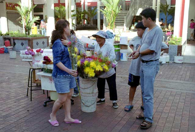 Flower selling infront of chinese temple. Singapore.