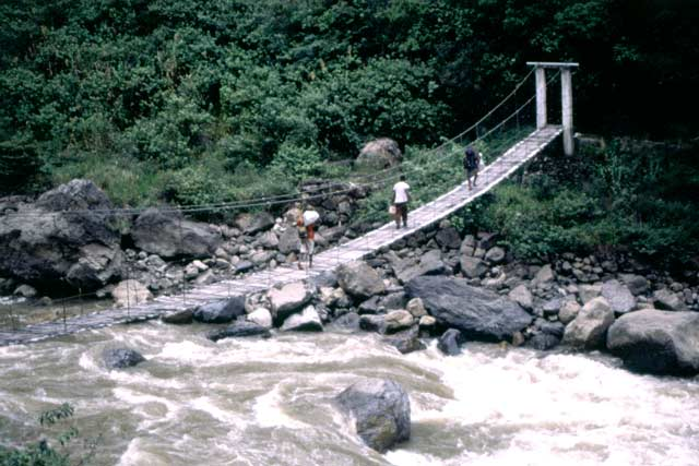 Crossing Baliem river using goverment bridge near Wamerek village. Papua,  Indonesia.