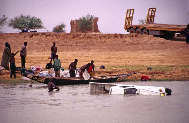 Car at Niger river. It fall from ferry. Mali.