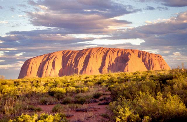 Ayers Rock (Uluru) in afternoon sun. Australia.