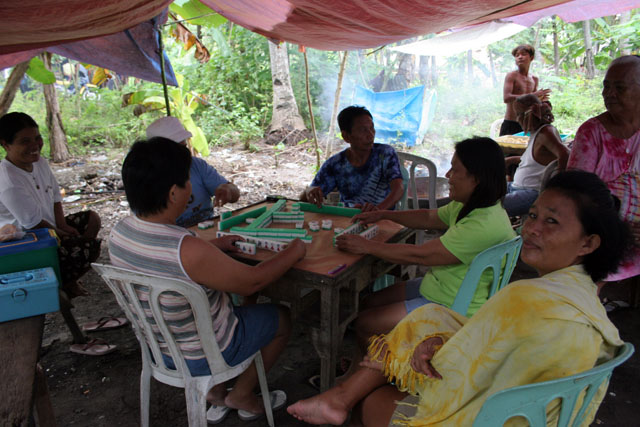 Chinese domino-like game is very popular. Malapascua. Philippines.