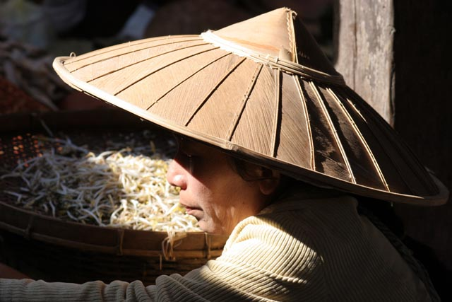 Woman from Intha tribe at Inle Lake market. Myanmar (Burma).