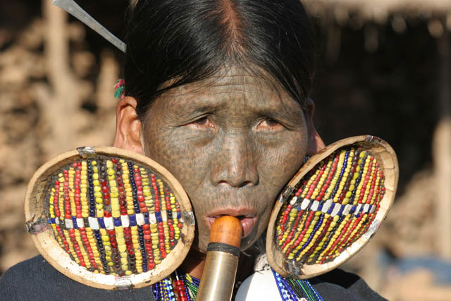 Woman from Makan Chin tribe, Mindat village, Chin State. Women decorate their faces traditionaly by tattoo. Different tribes use different tattoo ornaments. Myanmar (Burma).