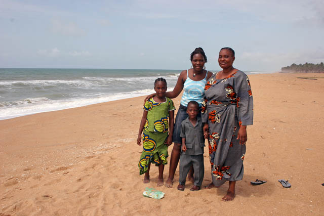 Local family at trip to sea, Ouidah town. Benin.