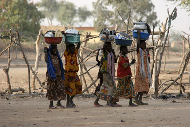 Are they on the way back from market or dishes washing? Lake Chad area. Cameroon.