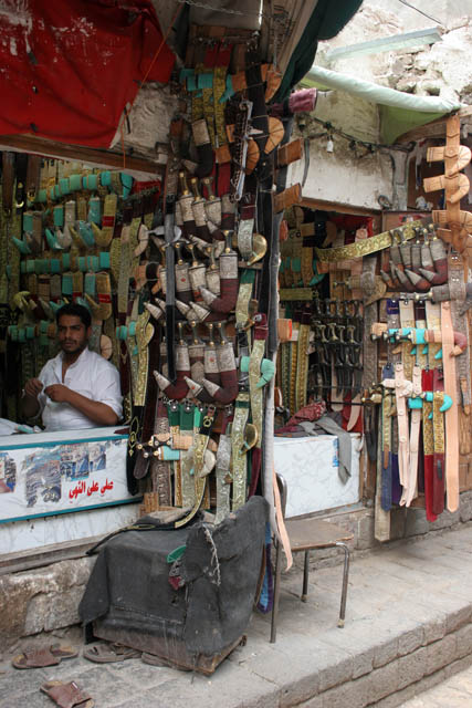 Shop with traditional daggers jambiya - almost every man is decorated by one. Market (souq) at old quarter of Sana city. Yemen.
