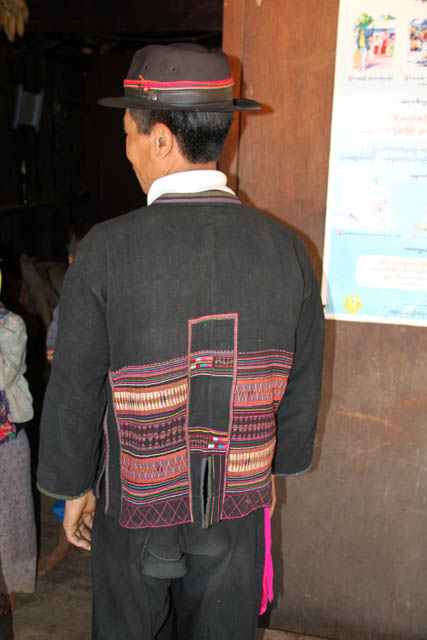 Akha man at traditonal clothes, area around Kengtung town. Traditionaly clothes are embroidered very much. Myanmar (Burma).