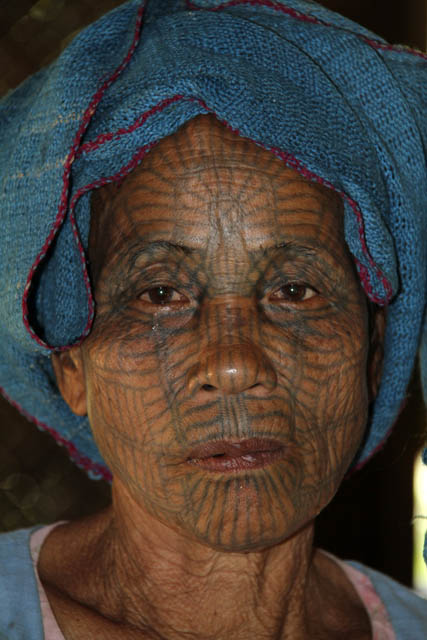 Woman from Chin tribe, Mrauk U area. Women have tradtionaly tattooed their faces. Myanmar (Burma).