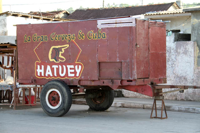 Nice beer advertising at cart - use of the cart is unknown. Baracoa town. Cuba.