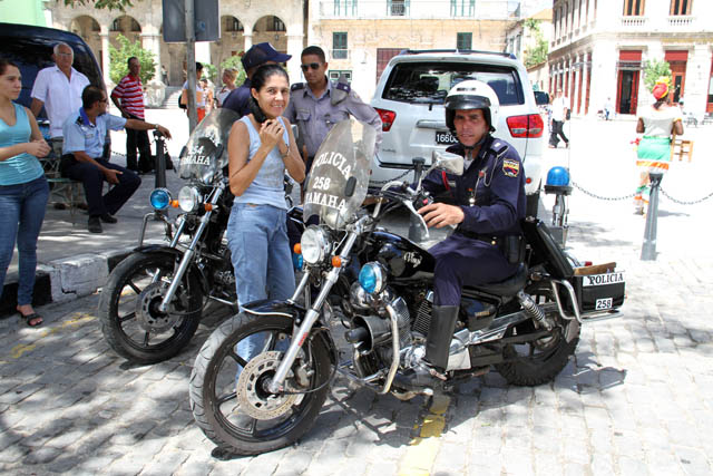 Policemen at their motorcycles, old Havana (Habana Vieja). Cuba.