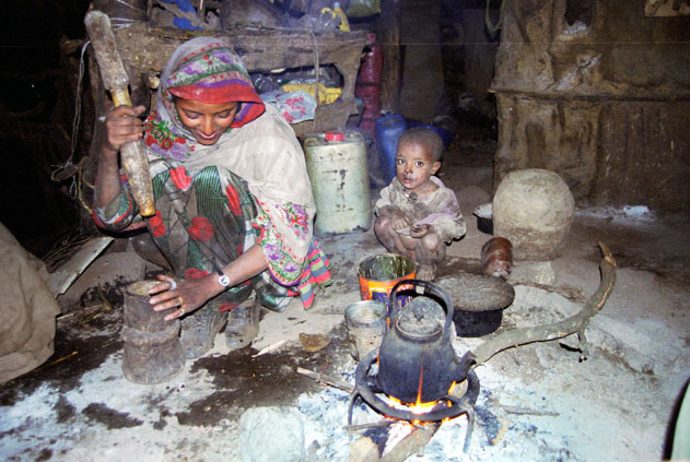 Coffee preparation during coffee ceremony. Local village at Simien mountains. North,  Ethiopia.