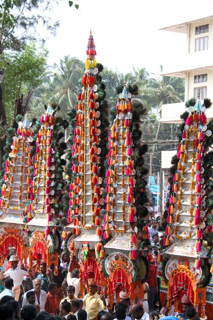 Thaipooya Mahotsavam Festival and ambalakkavadi - decorated model of a temple which a male devotee carries on his shoulders. Sree Maheswara Temple at Koorkancheri in the Thrissur town at Kerala. India.